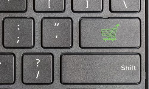 shopping-cart-icon-on-computer-keyboard-PKRKWB6-1536x1024